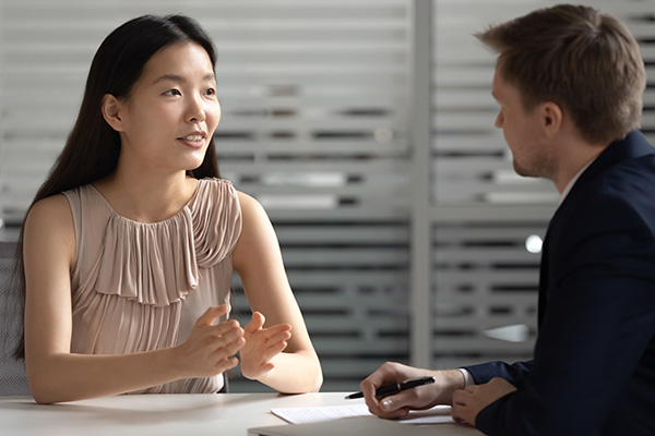 Man and Women talking in an interview