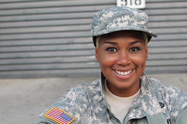Women Veteran smiling at the camera